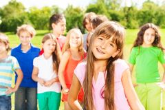 Happy girl and her friends Stock Images