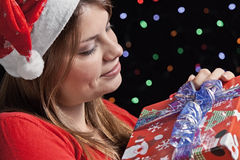 Happy girl with her gift. Girl looks happy his gift Stock Photography
