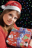 Happy girl with her gift. Girl under a shower of colored lights Christmas Royalty Free Stock Image