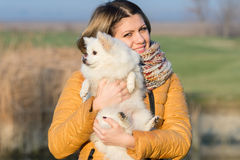 Happy girl with her little dog Stock Photography
