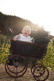 Happy girl in her pram Stock Photography