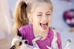 Happy girl with a dog. Happy girl with her puppy Stock Photos