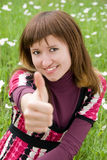 Happy girl with her thumb up Royalty Free Stock Photos