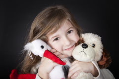 Happy girl with her toy friends Stock Photo
