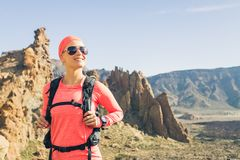 Happy girl hiker reached mountain top, backpacker adventure royalty free stock photo