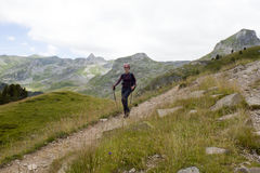 Happy girl hiking the mountains in Pyrenees Stock Photo