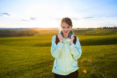 Happy girl hiking in nature. Royalty Free Stock Photography
