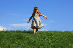 Happy girl on the hill. Happy girl on the grass Royalty Free Stock Photo