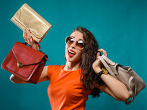 Happy girl hold  bags. Red dress. female beautiful model. Royalty Free Stock Photo