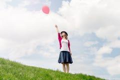 Happy girl holding air balloon Stock Photos