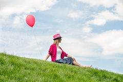 Happy girl holding air balloon Stock Photography