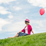 Happy girl holding air balloon Stock Photo