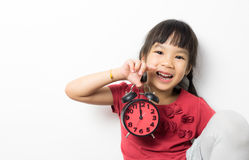 Happy girl is holding alarm clock for lunch time. Royalty Free Stock Photos