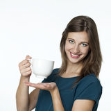 Happy girl holding a big white mug of tea Stock Photography