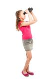 Girl searching for something with binoculars Stock Images