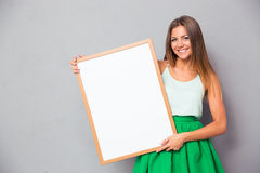 Happy girl holding blank board Stock Photos
