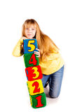 Happy girl holding blocks with numbers Royalty Free Stock Photography