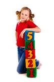 Happy girl holding blocks with numbers. Over white background Stock Images