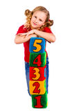 Happy girl holding blocks with numbers. Over white background Stock Photo