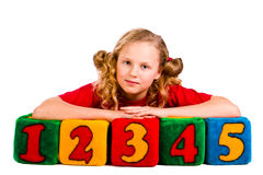 Happy girl holding blocks with numbers. Over white background Stock Photos