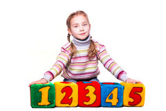 Happy girl holding blocks with numbers. Over white background Royalty Free Stock Photography