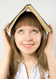 Happy girl holding book Royalty Free Stock Images