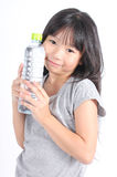 Happy girl holding a bottle of water. Royalty Free Stock Photography