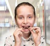 Happy girl holding braces Stock Images