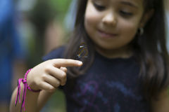 Happy Girl Holding a Butterfly Stock Image