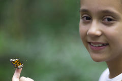 Happy Girl Holding a Butterfly Royalty Free Stock Photography