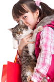 Happy girl holding cat Stock Images
