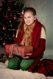 Happy Girl Holding Christmas Present Stock Photos