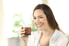 Girl holding a cocoa shake looking at you Stock Photo