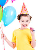 Happy girl holding colorful balloons. Royalty Free Stock Image