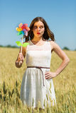 Happy girl holding colorful ribbons Royalty Free Stock Image
