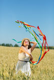 Happy girl holding colorful ribbons Stock Images