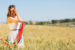 Happy girl holding colorful ribbons Royalty Free Stock Images