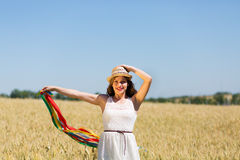 Happy girl holding colorful ribbons Royalty Free Stock Photos