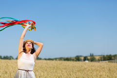 Happy girl holding colorful ribbons Stock Photography