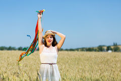 Happy girl holding colorful ribbons Stock Photo