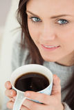 Happy girl holding a cup of coffee Royalty Free Stock Photos