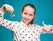 Happy girl holding dental braces Stock Images