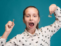 Happy girl holding dental braces Royalty Free Stock Image