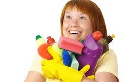 Happy girl holding dish washing liquids Stock Photo