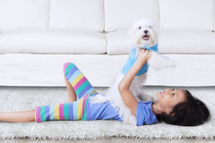 Happy girl holding dog Royalty Free Stock Photos