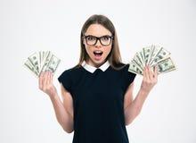 Happy girl holding dollar bills Stock Photo