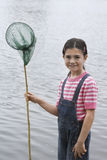 Happy Girl Holding Fishing Net By Lake Royalty Free Stock Photos