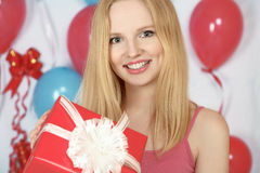 Happy girl holding gift Royalty Free Stock Photography