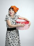 Happy girl holding gift box with red polka dots Royalty Free Stock Images