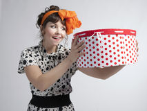 Happy girl holding gift box with red polka dots Stock Photography